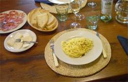 Fresh pasta with white truffles, pecorino with truffles and home-made prosciutto